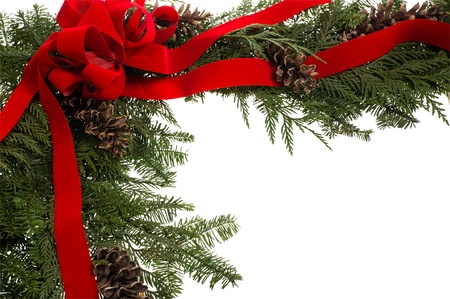 Christmas corner border with pine cones and red bow Stock Photo - 14760760