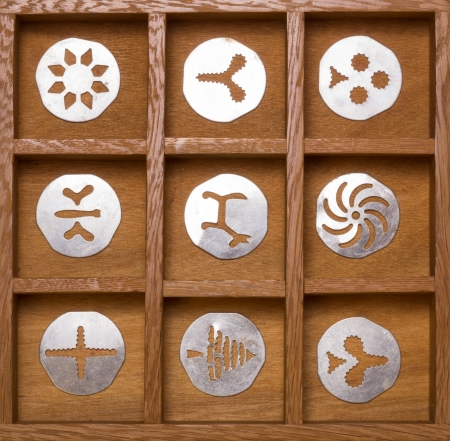 Wooden shadow box with antique cookie cutters