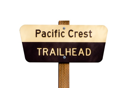Pacific Crest Trail sign on wooden post isolated on white photo