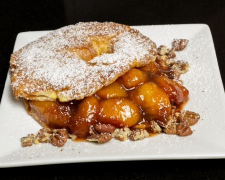 Fresh dessert of peaches croisant and nuts