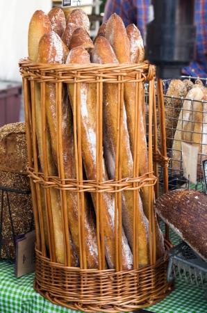 A wicker basket of freshly baked bread Standard-Bild