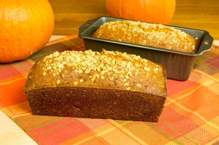 Loaves of fresh pumpkin bread with pumpkins Stock Photo