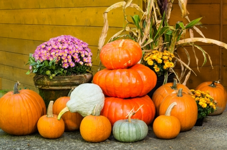 Fall display of decorations with pumpkins and flowers Stock Photo