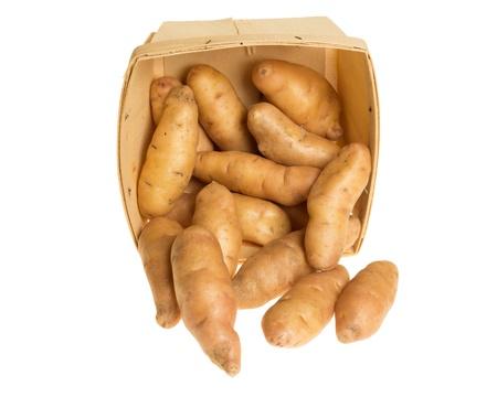 fingerling: Box of fresh fingerling potatoes isolated on white Stock Photo