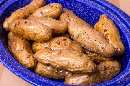 fingerling: Blue dish with baked fingerling potatoes