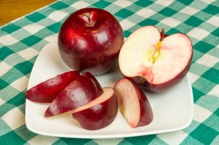 Rome Beauty apple sliced on white plate Reklamní fotografie