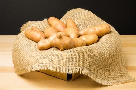 fingerling: A basket of fresh fingerling potatoes Stock Photo
