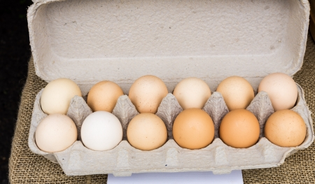 Carton of brown organic chicken eggs at the market Stock Photo