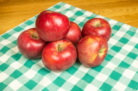 winesap apple: Winesap apples on a checked cloth