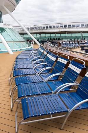 lounge: Folding lounge chairs on a cruise ship deck