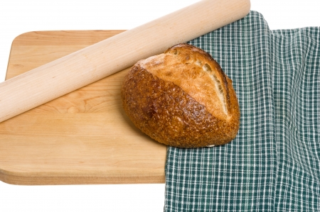 pin board: A loaf of bread with rolling pin and cutting board Stock Photo