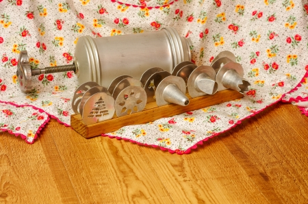 A vintage cookie press on a printed apron Stock Photo - 17002034
