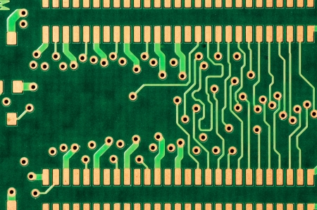 A closeup of a printed circuit board for memory chip