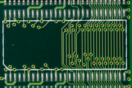 A closeup of a printed circuit board with silver traces photo
