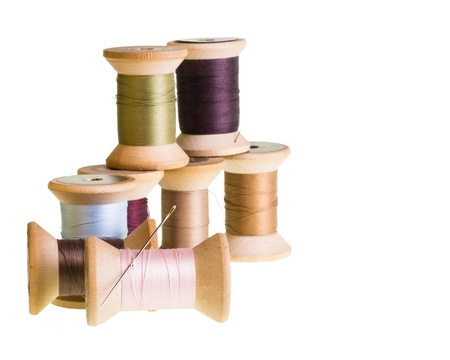 Group of wooden thread spools isolated on white Stock Photo
