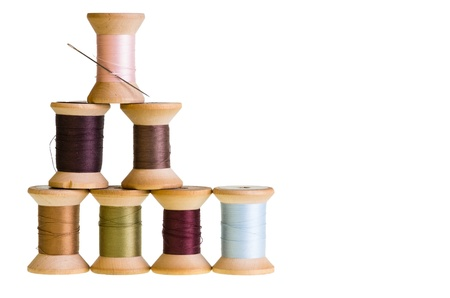 Seven spools of sewing thread isolated on white