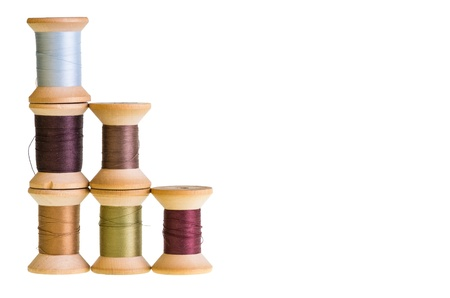 Six spools of sewing thread isolated on white Stock Photo