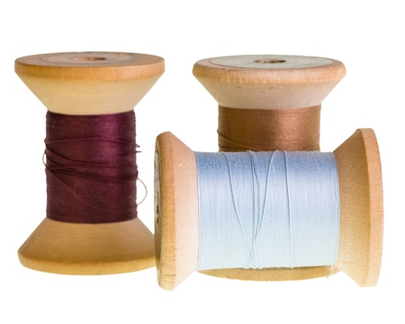 Three spools of sewing thread isolated on white