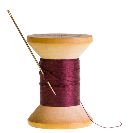 Needle with spool of red sewing thread Stock Photo