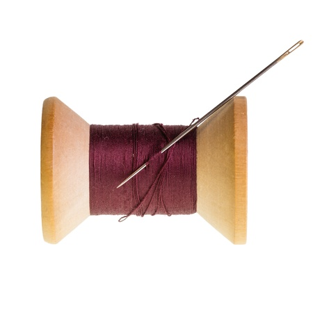 Spool of red sewing thread isolated on white
