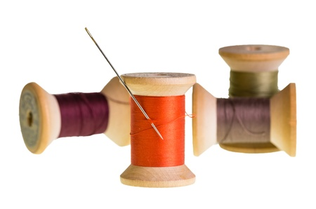 Spools of sewing thread with a needle