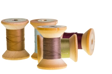 Spools of sewing thread isolated on white Stock Photo