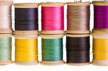Group of spools of sewing thread isolated on white Stock Photo