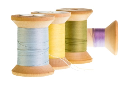 Four spools of sewing thread isolated on white