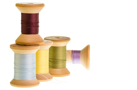 Five spools of sewing thread isolated on white