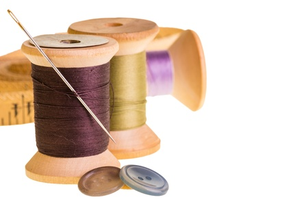 Sewing thread with buttons and measuring tape