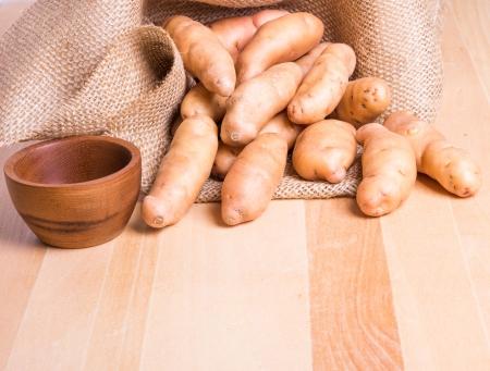 fingerling: Fresh fingerling potatoes with burplap sack