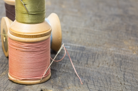 Spools of sewing thread stacked on a table