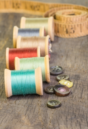Buttons and measuring tape with spools of thread