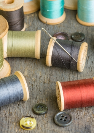 Buttons and spools of thread with a needle