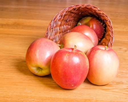 Red Fuji apples spilling from a cornucopia