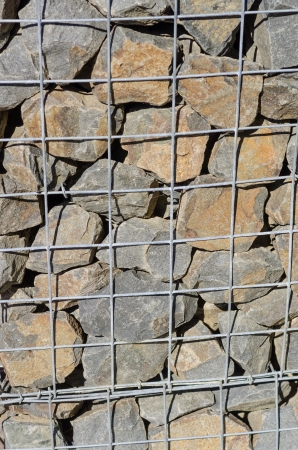 wire mesh: A retaining wall made from wire mesh and stone