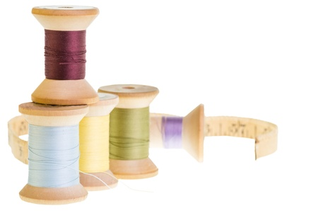 Spools of sewing thread with measuring tape