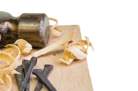 A hammer and nails on a wood board with sawdust shavings Stock Photo - 17571851