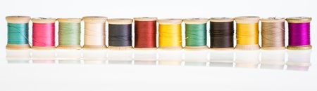 A row sewing thread with reflection