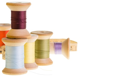 Spools of sewing thread with a measuring tape