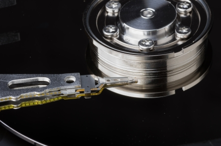 electromagnetism: Platter and read head of a computer hard disk Stock Photo