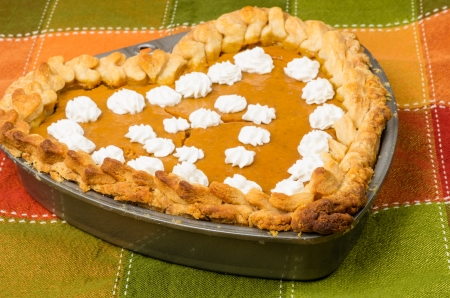 A fresh baked pumpkin pie in a heart shaped pan Stock Photo - 18841301