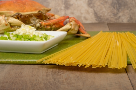 dungeness: Pasta and Dungeness Crab ready to make crab spaghetti pasta Stock Photo