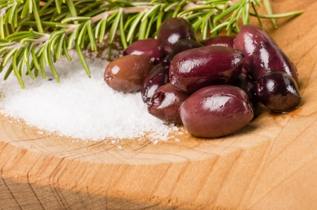 kalamata: Kalamata olives with rosemary and salt ready to prepare