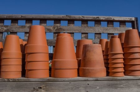 A shelf of clay or terracotta planting pots ready for gardening