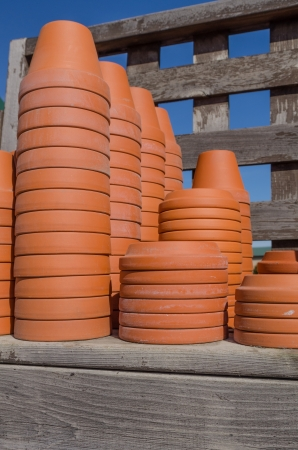 A shelf of clay planting pots ready for gardening