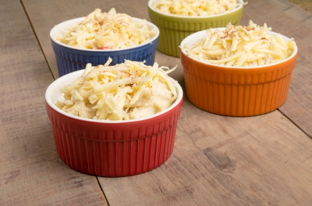 dungeness: Four bright bowls of Dungeness Crab macaroni and cheese ready to go into the oven