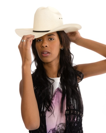 An attractive young African American woman in a white hat isolated photo