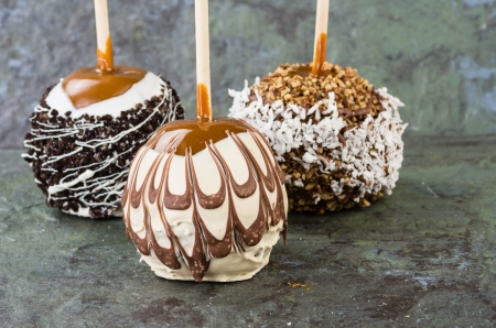taffy apple: Sweet chocolate or caramel covered apples with nuts Stock Photo