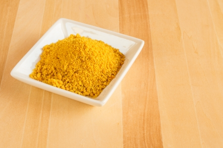 tumeric: A white plate of tumeric spice for use in cooking